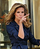 Non-Exclusive<br /> 2012 June 22 - Heidi Klum's makes a funny expression with her fingers while filming a commercial in NYC. Photo Credit Jackson Lee