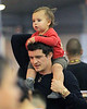 Exclusive<br /> 2012 June 22 - Orlando Bloom gives baby Flynn a piggyback ride and kisses him after they touch down at JFK Airport in NYC. Photo Credit Jackson Lee