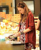 Non-Exclusive<br /> 2012 June 8 - Elizabeth Olsen sets her eyes a long piece of bread while shopping in Whole Foods in NYC. Photo Credit Jackson Lee