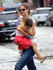 Non-Exclusive<br /> 2012 July 29 - Suri Cruise is worried about her flip-flops as Katie Holmes picks her up in the Meatpacking District in NYC. Photo Credit Jackson Lee