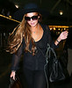 Non-Exclusive<br /> 2012 Aug 22 - Lindsay Lohan arrives in NYC with her family after her guests are accused of stealing jewelry at a multimillion dollar house in LA. Photo Credit Jackson Lee