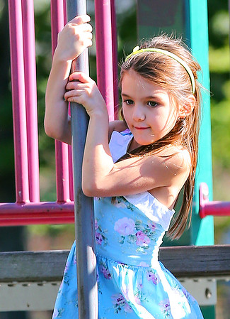Non-Exclusive<br /> 2012 Sept 23 - Suri Cruise slides down a pole at the playground in Brooklyn, NY. Photo Credit Jackson Lee