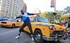 Non-Exclusive<br /> 2012 Oct 13 - Usain Bolt strikes his famous lighting bolt pose in front of a vintage taxicab with the Empire State Building and Radio City Music Hall in the background. Photo Credit Jackson Lee