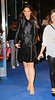 Non-Exclusive<br /> 2012 Oct 22 - Katie Holmes looks radiant in a black mini trench coat at a Kohl's event in NYC. Photo Credit Jackson Lee