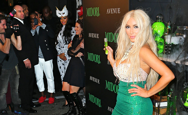 Non-Exclusive<br /> 2012 Oct 27 - Kanye West takes video of Kim Kardashian while she is on the green carpet at Midori Halloween event in NYC. Photo Credit Jackson Lee