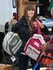 Non-Exclusive<br /> 2012 Nov 10 - Jessica Biel hands over bookbags filled with blankets and first aid kits to Superstorm Sandy victims in Far Rockaways, NYC. Photo Credit Jackson Lee