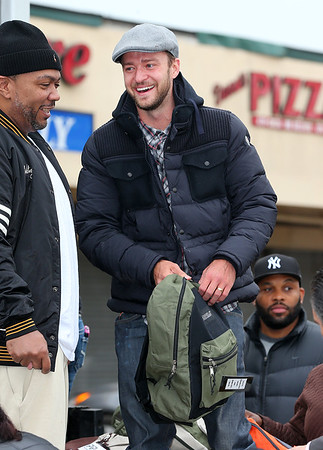 Non-Exclusive<br /> 2012 Nov 10 - Justin Timberlake hands over bookbags filled with blankets and first aid kits to Superstorm Sandy victims in Far Rockaways, NYC. Photo Credit Jackson Lee
