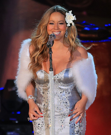 Non-Exclusive<br /> 2012 Nov 27 - Mariah Carey performs with Santa Claus for Rockefeller Center tree lighting in NYC. Photo Credit Jackson Lee