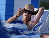 Non-Exclusive<br /> 2012 Dec 11 - Kate Walsh flips the bird at the paps at Miami Beach, FL. Photo Credit Jackson Lee