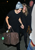 Exclusive<br /> 2013 Jan 1 - Taylor Swift and Harry Styles head into their hotel hand-in-hand moments after kissing each other in Times Square during New Year's celebration. Photo Credit Jackson Lee
