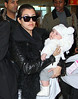 Non-Exclusive<br /> 2013 Jan 14 - Kourtney Kardashian carries baby Penelope to NYC for the first time with Kim Kardashian at JFK Airport. Photo Credit Jackson Lee