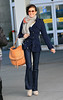 Non-Exclusive<br /> 2013 Feb 17 - Teri Hatcher is all smiles when she arrives at JFK Airport in NYC. Photo Credit Jackson Lee