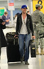 Exclusive<br /> 2011 May 4 - Ryan Gosling is all smiles while carrying his guitar and luggage in JFK airport in NYC. Photo Credit Jackson Lee