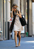 Exclusive<br /> 2011 May 8 - Annalynne McCord fixes her scarf and texts at the same time while out and about in NYC. Photo Credit Jackson Lee