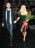 Non-Exclusive <br /> 2011 May 16 - Christina Aguilera comes back to her hotel with a bouquet of roses with boyfriend Matt Rutler in NYC. Photo Credit Jackson Lee