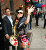 Non-Exclusive<br /> 2011 May 23 - Lady Gaga throws Rose petals at the paparazzi when arriving at the David Letterman Show in NYC. Photo Credit Jackson Lee