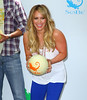 Non-Exclusive<br /> 2011 May 25 - Hilary Duff holds up a couple of melons at Sobe life water event in NYC. Photo Credit Jackson Lee