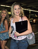 Non-Exclusive<br /> 2011 May 30 - American Idol runner up and winner Laura Alaina and Scotty McCreery arrive at JFK Airport in NYC. Photo Credit Jackson Lee
