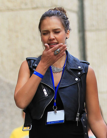 NON-EXCLUSIVE<br /> 2011 June 4 - Jessica Alba sneezes into her hand, not her elbow in New Haven, CT.  According to the Center of Disease Control (CDC), if you don't have a tissue, cough or sneeze into your upper sleeve or elbow, not your hands. Photo Credit Jackson Lee