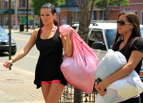 2011 June 30 - Nicole 'Snooki' Polizzi lights up while walking with Ronnie Ortiz-Magro on the Boardwalk at Seaside Heights, NJ.  Photo credit Jackson Lee