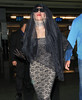 Non-Exclusive <br /> 2011 July 14 - Lady Gaga arrives at JFK airport wearing a lacy outfit and veil covering up her face, NYC. Photo Credit Jackson Lee