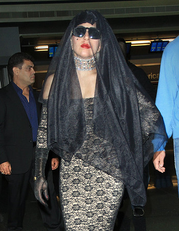 2011 July 14 - Lady Gaga arrives at JFK airport in NYC wearing a lace outfit and veil. Photo credit Jackson Lee
