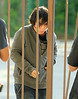 Non-Exclusive <br /> 2011 July 15 - Vanessa Hudgens picks garbage from the trash bin and goes through a fence  on the set of 'Gimme Shelter' in Newark, NJ.  Photo Credit Jackson Lee   Photo Credit Jackson Lee