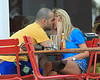 Exclusive <br /> 2011 July 24 - Tara Reid kisses, takes photos with her boyfriend and chows down with her dog Pasha in tow in Atlanta, Ga.  Photo Credit Jackson Lee