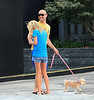 Exclusive <br /> 2011 July 24 - Tara Reid bends over to pick up poop from her dog Pasha while her boyfriend looks on in Atlanta, GA.  Photo Credit Jackson Lee