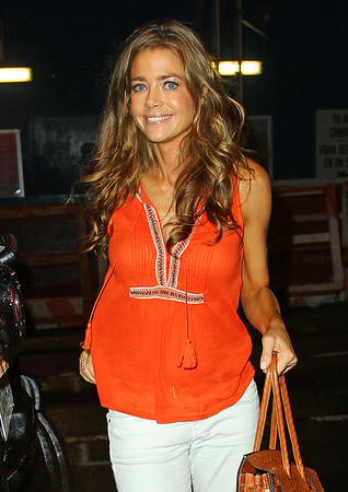 Non-Exclusive<br /> 2011 July 29 - Denise Richards is all smiles while pushing baby Eloise in a stroller back to her hotel in NYC. Photo credit Jackson Lee