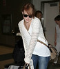 Non-Exclusive <br /> 2011 Aug 10 - Emma Stone arrives at JFK airport in NYC.  Photo Credit Jackson Lee