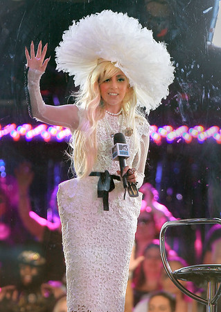 NON EXCLUSIVE<br /> 2011 August 18 - Lady Gaga greets the crowd from MTV studios in Times Square, NYC.  Photo Credit Jackson Lee