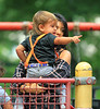 Non-Exclusive <br /> 2011 Sep 2 - Kourtney Kardashian goes down the slide with Mason Disick in a playground in Central Park in NYC.   Photo Credit Jackson Lee