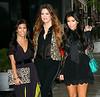 Non-Exclusive <br /> 2011 Sept 6 - Kim Kardashian, Kourtney Kardashian, and Khloe Kardashian brave the rain while out and about to promote their show in NYC   Photo Credit Jackson Lee