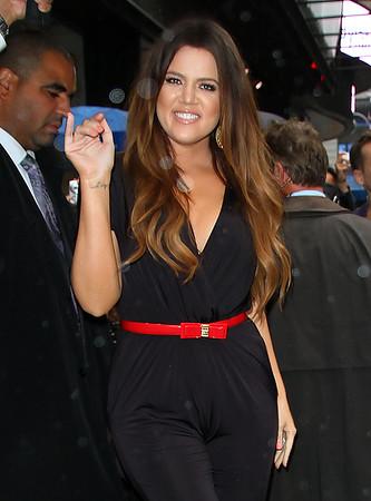 Non-Exclusive <br /> 2011 Sept 7 - Kim Kardashian, Kourtney Kardashian, Khloe Kardashian depart GMA in NYC.  Photo Credit Jackson Lee