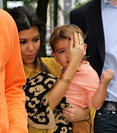 NON EXCLUSIVE<br /> 2011 Sept 28 - Kourtney Kardashian covers up Mason's bandages with her hand when coming out of the plastic surgeon's office in NYC with Scott Disick.  Photo Credit Jackson Lee
