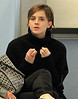 Exclusive<br /> 2011 Oct 2 - Emma Watson talks with a friend in the airport in Newark, NJ. Photo Credit Jackson Lee