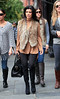 Non-Exclusive<br /> 2011 Oct 15 - Kourtney Kardashian jumps over a puddle when coming out of Bar Pitti restaurant in NYC. Photo Credit Jackson Lee