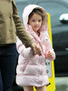 Exclusive<br /> 2011 Oct 19 - Katie Holmes and Suri Cruise out and about in NYC. Katie Holmes looks thin while walking in the rain in NYC, while Suri Cruise is seen waving at the cameraman. Photo Credit Jackson Lee