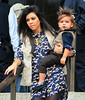 Non-Exclusive<br /> 2011 Oct 21 - Mason Disick points at a pigeon while in the arms of mom Kourtney Kardashian at the American Museum of Natural History in NYC. Aunt Kim Kardashian came along too!  Photo Credit Jackson Lee