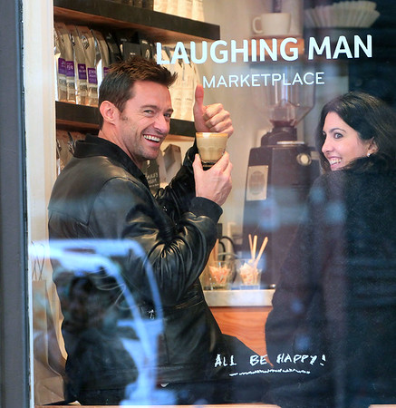 Non-Exclusive<br /> 2011 Oct 23 - Hugh Jackman visits the quaint tea shop that he opened in NYC.  The 43-year-old actor has opened up his own cafe- called Laughing Man Coffee & Tea in New York.  He went to visit it and posed for photos with fans, while daughter Ava looks out of the window of the shop.. Photo Credit Jackson Lee