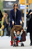 Non-Exclusive<br /> 2011 Nov 13 - Miranda Kerr carries her adorable son Flynn on Sunday (November 13) in New York City. Photo Credit Jackson Lee