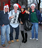 """Non-Exclusive<br /> 2011 Dec 23 - Rosario Dawson is all smiles while posing for pics with """"street"""" santas in NYC. Photo Credit Jackson Lee"""