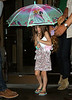 Non-Exclusive <br /> 2011 Aug 9 - Tom Cruise, Katie Holmes, Suri Cruise with her little umbrella depart NYC.  Photo Credit Jackson Lee