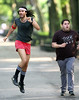30 July 2009 - Russell Brand sniffs cocaine off his arm then clowns around with Jonah Hill on the set of 'Get him to the Greek' in Central Park, NYC. Photo Credit Jackson Lee