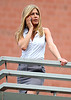 21 Aug 2009 - Jennifer Aniston looks like she's about to jump over the edge of a building on the set of 'The Bounty' in NYC.  Photo Credit Jackson Lee