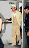 25 Sept 2009 - Brad Pitt takes Maddox Pitt-Jolie (holding a take-out box) to play at Dave & Busters in Times Square, NYC then jets off to JFK Airport.  Photo Credit Jackson Lee