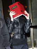 22 Sept 2009 - Madonna inexplicably uses a a book titled 'The Zohar' as a cover while out and about with Jesus Luz in NYC. Photo Credit Jackson Lee