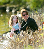 12 Oct 2009 - Tom Cruise and Katie Holmes take Suri Cruise to play on the banks of the Charles River in Cambridge, MA.  Photo Credit Jackson Lee