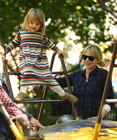 EXCLUSIVE<br /> 25 Oct 2009 - Michelle Williams takes Matilda Ledger out to the playground on a beautiful autumn day where she petted a dog, rode a slide, played in a sandbox, and climbed a concrete dolphin in NYC.  Photo Credit Jackson Lee